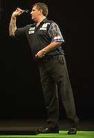 21.05.2015. London, England. Betway Premier League Darts Play-Offs.   Gary Anderson [SCO] in action during the final against Michael van Gerwen [NED].  Betway Premier League final at The O2 in London on Thursday May 21.
