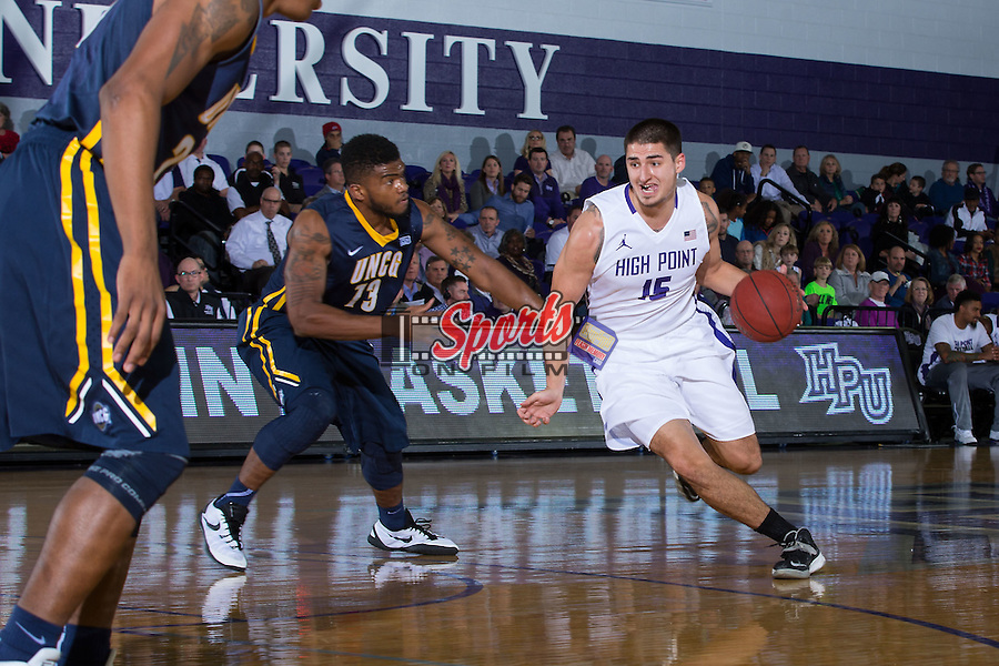 Lorenzo Cugini (15) of the High Point Panthers dribbles past Kayel Locke (13) of the UNCG Spartans during first half action at Millis Athletic Center on December 9, 2015 in High Point, North Carolina.  The Panthers defeated the Spartans 90-72.   (Brian Westerholt/Sports On Film)