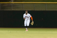 Scottsdale Scorpions center fielder Ronnie Dawson (4), of the Houston Astros organization, pursues a fly ball during an Arizona Fall League game against the Surprise Saguaros at Scottsdale Stadium on October 15, 2018 in Scottsdale, Arizona. Surprise defeated Scottsdale 2-0. (Zachary Lucy/Four Seam Images)
