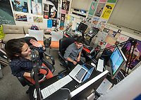 "KOXY DJs Javier Silva '17 and Julia D'Amours '17 play music and talk during their show, ""Alone Together"" on Dec. 2, 2013 in the Johnson Student Center college radio station booth. (Photo by Marc Campos, Occidental College Photographer)"