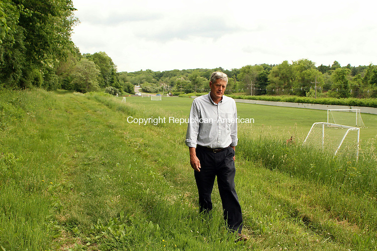 WATERTOWN, CT June 04 2014-060414LW01 - Town Engineer Charles Berger walks the future path of the Steele Brook Greenway around UNICO Fields in Watertown Wednesday.<br />