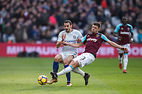 Aaron Cresswell of West Ham United tackles David Zappacosta of Chelsea during the Premier League match between West Ham United and Chelsea at the Olympic Park, London, England on 9 December 2017. Photo by Andy Rowland.