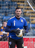 Goalkeeper Scott Shearer of Mansfield Town warms up during the Sky Bet League 2 match between Wycombe Wanderers and Mansfield Town at Adams Park, High Wycombe, England on 25 March 2016. Photo by Andy Rowland.