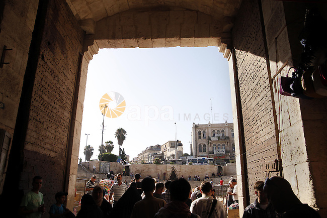 Palestinians walk out at Damascus gate near al-Aqsa mosque in Jerusalem's Old City, June 26, 2013. Photo by Saeed Qaq