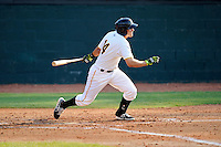 Third baseman Jose Salazar (14) of the Bristol Pirates bats in a game against the Greeneville Astros on Saturday, July 26, 2014, at DeVault Memorial Stadium in Bristol, Virginia. Greeneville won, 2-1 in Game 1 of a doubleheader. (Tom Priddy/Four Seam Images)