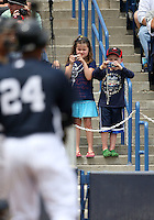 April 3, 2010:  Two young fans take photos of Robinson Cano of the New York Yankees in the annual Yankees Futures Game during Spring Training at Legends Field in Tampa, Florida.  Photo By Mike Janes/Four Seam Images