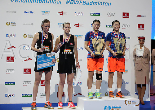 13.12.2015. Dubai, UAE.  China's twin sisters Luo Ying (L) and Luo Yu and Denmarks Christinna Pedersen (2nd L) and Kamilla Pytter Juh celebrate on the podium during the awards ceremony for the womens doubles event at the Dubai World Superseries Finals badminton tournament in Dubai, the United Arab Emirates, Dec. 13, 2015. Luo Ying and Luo Yu beat Denmark s Christinna Pedersen and Kamilla Pytter Juh in the final by 2-1.