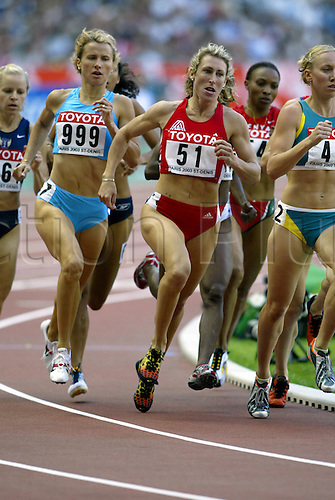 August 24, 2003: Distance runner, 51. STEPHANIE GRAF (AUT) runs alongside 999. BRIGITA LANGERHOLC (SLO), during the Women's 800m Semi-Finals. World Athletics Championships held at the Stade de France, Paris. Photo: Neil Tingle/action plus...run runs running runners woman women metres.sprint sprinting athlete 030824 track and field
