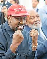 Kanye West, left, makes a statement to the media as he meets with United States President Donald J. Trump and NFL great Jim Brown, right, in the Oval Office of the White House in Washington, DC on Thursday, October 11, 2018.<br /> Credit: Ron Sachs / CNP /MediaPunch