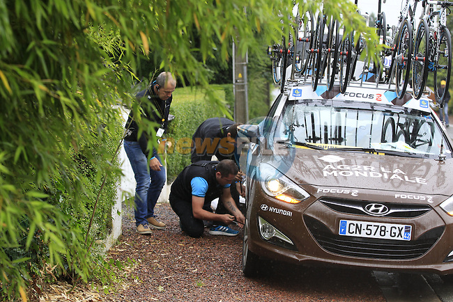 Puncture for AG2R La Mondiale team car before the1st cobbled sector 9  from Gruson to Crossroads de l'Arbe during Stage 5 of the 2014 Tour de France running 155.5km from Ypres to Arenberg. 9th July 2014.<br /> Picture: Eoin Clarke www.newsfile.ie
