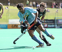 India's Tushar Khandekar keeps the ball from Nick Haig during the international hockey match between the New Zealand Black Sticks and India at National Hockey Stadium, Wellington, New Zealand on Saturday, 20 February 2009. Photo: Dave Lintott / lintottphoto.co.nz