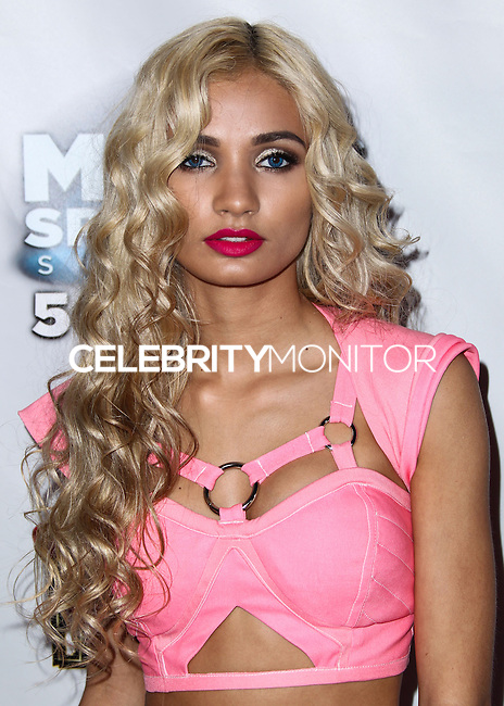 "UNIVERSAL CITY, CA, USA - APRIL 19: Singer Pia Mia poses backstage at the Pia Mia And Dev Concert As Part Of The ""Spring Concert Series"" Presented By AMP 97.1 Radio held at 5 Towers Outdoor Concert Arena at Universal CityWalk on April 19, 2014 in Universal City, California, United States. (Photo by Xavier Collin/Celebrity Monitor)"