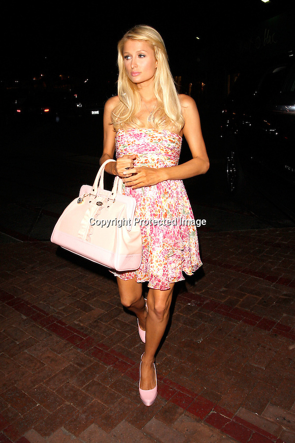 .8-24-08.Paris Hilton leaving nobu sushi restaurant in Malibu with sister Nicky Hilton walking hand & hand like a butterfly in the wind..www.AbilityFilms.com.805-427-3519.AbilityFilms@yahoo.com