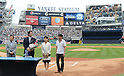 Hideki Matsui,<br /> JULY 28, 2013 - MLB :<br /> Hideki Matsui stands with his father Masao, mother Saeko and brother prior to signing his reitement papers as his fans are shown on the screen during his official retirement ceremony before the Major League Baseball game against the Tampa Bay Rays at Yankee Stadium in The Bronx, New York, United States. (Photo by AFLO)