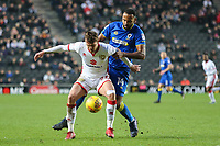 Alex Gilbey of MK Dons holds off Liam Trotter of AFC Wimbledon during the Sky Bet League 1 match between MK Dons and AFC Wimbledon at stadium:mk, Milton Keynes, England on 13 January 2018. Photo by David Horn.