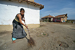 "THIS PHOTO IS AVAILABLE AS A PRINT OR FOR PERSONAL USE. CLICK ON ""ADD TO CART"" TO SEE PRICING OPTIONS.   Pepa Adre, 25, sweeps the ground around her home in a largely Roma, Turkish-speaking neighborhood of Dobrich, in the northeast of Bulgaria."