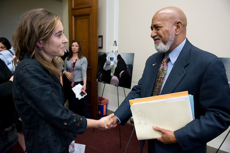 Photographer Gabriela Bulisova speaks with Rep. Alcee Hastings, D-Fla., about her photos of Iraqi refugees at the exhibit in the Rayburn House Office Building on Wednesday, April 30, 2008. Rep. Hastings co-hosted the photo exhibit.