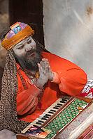 Pashupatinath, Nepal.  Sadhu (Holy Man) at Nepal's Holiest Hindu Temple, Giving the Namaste Greeting.