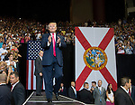 JACKSONVILLE, FL - AUGUST 03: Donald Trump makes his entrance during a rally at Jacksonville Veterans Memorial Arena on August 3, 2016 in Jacksonville, Florida. (Photo by Mark Wallheiser/Getty Images)