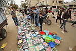 Palestinian vendors display all kinds of used goods at El-Yarmouk market in Gaza city, on March 26, 2016. Photo by Mohammed Asad