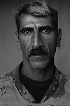 Pvt. Abbas Awad Shakir, 36, Hillah, Farmer, 4th Co., 2nd Battalion, 7th Division of the Iraqi Army in Haditha, Iraq on Sun. Nov. 27, 2005.