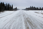 Dirt road swept by cold winter winds, Riding Mountain National Park, Manitoba, Canada