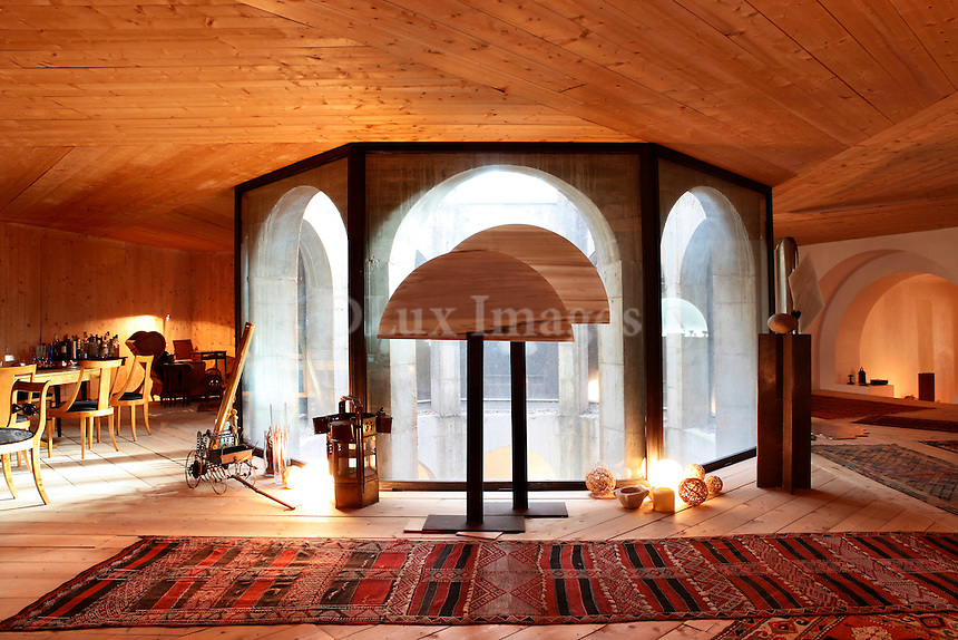 wooden lounge with arched doors