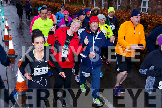 Mary Toomey (Listowel) gives the thumbs up with Danny Coffey of Tralee at the start of the Optimal Fitness 5 & 10k run on New Years Eve morning.
