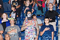 "Audience members stand for the US National Anthem before a WWE Live Summerslam Heatwave Tour event at the MassMutual Center in Springfield, Massachusetts, USA, on Mon., Aug. 14, 2017. Jeramy Martinez, 31, of Springfield, Mass., wore a skull mask like one that used to be worn by WWE superstar The Shield. Asked how he feels about current WWE Champion Jinder Mahal, Martinez said, ""It's his time."""