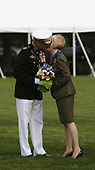 Out-going Chairman of the Joint Chiefs of Staff, US Marine Corps General Peter Pace is kissed by his wife, Lynne, during an Armed Forces Change of Command ceremony and official Hail and Farewell tribute in his honor attended by US President George W. Bush and in-coming Chairman of the Joint Chiefs of Staff US Navy Admiral Michael Mullen at Fort Myer, Virginia on October 1, 2007.<br /> Credit: Aude Guerrucci / Pool via CNP