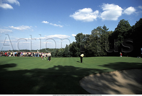 A golfer putts on the 9th green, G.A. European Golf Open, Sunningdale, 920913. Photo: Glyn Kirk/Action Plus....1992.crowd crowds.spectators spectator.golf.golfer golfers.green.sand trap bunker bunkers.putt putting.course courses.venue venues