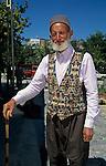 Turkish man in Kilim vest on street near Cappodocia Turkey.