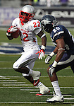 Nevada defender Duke Williams pursues New Mexico running back Crusoe Gongbay during the second quarter of an NCAA college football game in Reno, Nev., on Saturday, Oct. 15, 2011. (AP Photo/Cathleen Allison)
