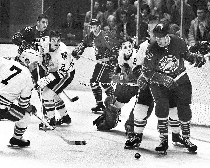 Seals vs BlackHawks...Seals Ted Hampson, Earl Ingarfield and Mike Laughton trie to score against Blackhawks Pit Martin, Gilles Marotte and goalie Denis DeJordy..(1969 photo by Ron Riesterer)