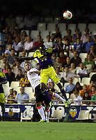 Valencia, Spain. Thursday 19 September 2013<br /> Pictured L-R: Juan Bernat of Valencia against Roland Lamah of Swansea <br /> Re: UEFA Europa League game against Valencia C.F v Swansea City FC, at the Estadio Mestalla, Spain,