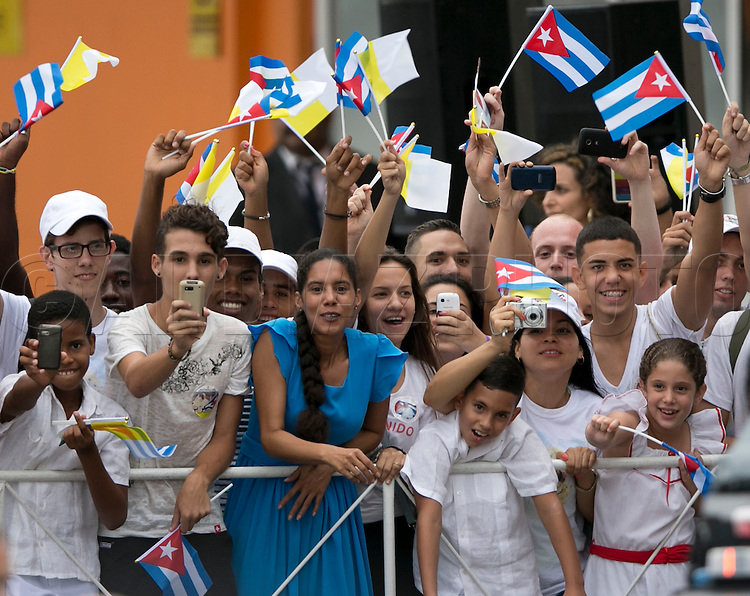 Cubans welcome Pope Francis as he arrives at the Jose Marti International Airport and is greeted by Cuban President Raul Castro in Havana, Cuba on Saturday, September 19, 2015.