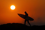 Surfer at sunset at Steamer Lane in Santa Cruz