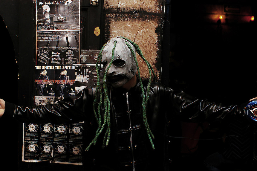 """A man with a mask poses for a portrait. """"Darkies"""" or """"Goths"""" at club Uta in the historic center of Mexico City. August 28"""