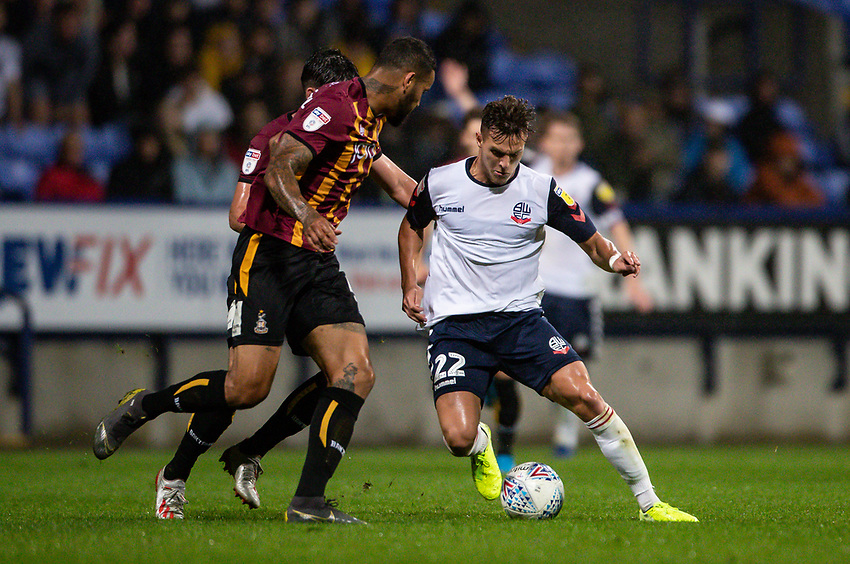 Bolton Wanderers' Dennis Politic (right) competing with Bradford City's Ben Richards-Everton <br /> <br /> Photographer Andrew Kearns/CameraSport<br /> <br /> EFL Leasing.com Trophy - Northern Section - Group F - Bolton Wanderers v Bradford City -  Tuesday 3rd September 2019 - University of Bolton Stadium - Bolton<br />  <br /> World Copyright © 2018 CameraSport. All rights reserved. 43 Linden Ave. Countesthorpe. Leicester. England. LE8 5PG - Tel: +44 (0) 116 277 4147 - admin@camerasport.com - www.camerasport.com