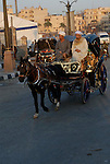 A caleche (carriage) in Luxor.The town of Luxor occupies the eastern part of a great city of antiquity which the ancient Egytians called Waset and the Greeks named Thebes.