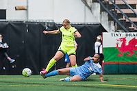 Seattle, WA - Sunday, May 22, 2016: Chicago Red Stars defender Casey Short (6) slides for the ball against Seattle Reign FC forward Merritt Mathias (9) during a regular season National Women's Soccer League (NWSL) match at Memorial Stadium. Chicago Red Stars won 2-1.