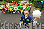 Casandra Buckley, teacher in the Holy Cross Mercy preschool, Killarney, and Kerry ladies footballer pictured with some of the pupils who came out in green and gold during the week to show their support for the Kerry ladies on Sunday...........................................................