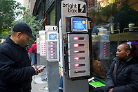 Bright Box, set up charging stations for people to charge their cell phones and lap tops in midtown in New York on Wednesday, October 31, 2012. Con Edison is estimating electricity will not be restored back to Lower Manhattan for several more days and a number of businesses are allowing people to charge their batteries.  (© Frances M. Roberts)