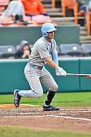 North Carolina Tar Heels catcher Brandon Martorano (4) swings at a pitch during a game against the Clemson Tigers at Doug Kingsmore Stadium on March 9, 2019 in Clemson, South Carolina. The Tigers defeated the Tar Heels 3-2 in game one of a double header. (Tony Farlow/Four Seam Images)