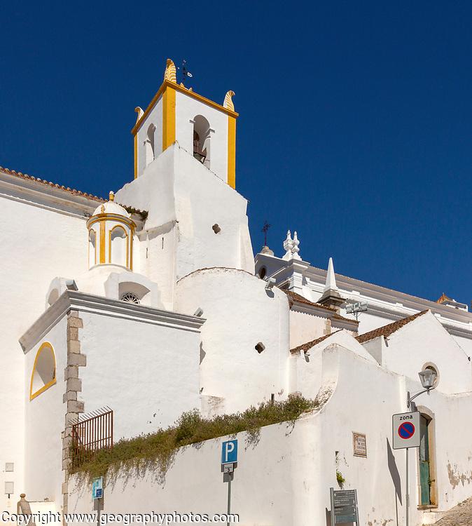 Whitewashed exterior walls and tower of Roman Catholic church Igreja de Santiago, Tavira, Algarve, Portugal, southern Europe