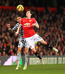 Michael Kightly of Burnley and Patrick McNair of Manchester United contest a header - Manchester United vs. Burnley - Barclay's Premier League - Old Trafford - Manchester - 11/02/2015 Pic Philip Oldham/Sportimage