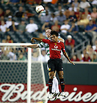 28 July 2004: Kieran Richardson (front) and Neil Lennon (rear) challenge for a header in the first half. Glasgow Celtic of the Scottish Premier League defeated Manchester United of the English Premier League 2-1 at Lincoln Financial Field in Philadelphia, PA in a ChampionsWorld Series friendly match..