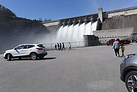 HIGH WATER SHOW<br />People gather Saturday March 21 2020 to watch lake water roar through the floodgates at Beaver Dam. The dam's seven floodgates are open 1.5 feet to lower the Beaver Lake level after heavy rain last week. Some 5.3 million gallons of water per minute, or 12,000 cubic feet per second, are flowing through the dam, according to Army Corps of Engineers information. The dam is located on Arkansas 187 about 25 miles northeast of Rogers or 9 miles west of Eureka Springs. Go to nwaonline.com/200322Daily/ to see more photos.<br />(NWA Democrat-Gazette/Flip Putthoff)