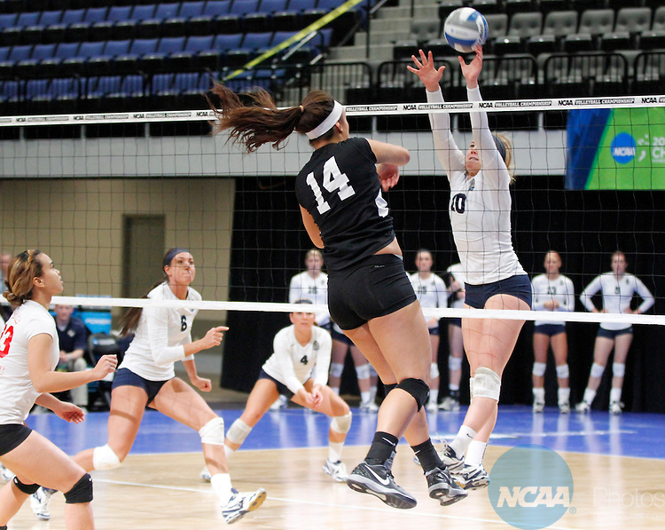 14 DEC 2013 Concordia-St. Paul's Erienne Lauersdorf (10) tries to block BYU-Hawaii's Noel Pauga (14) during the Division II Women's Volleyball Championship game held at the U.S. Cellular Center in Cedar Rapids, IA.  Concordia-St. Paul won over BYU-Hawaii in 3 straight sets to claim the championship title. Conrad Schmidt/NCAA Photos