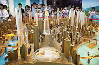 China. Shanghai. World Expo. Expo 2010 Shanghai China.  China Pavilion. A group of chinese tourists look inside the Chongquing pavilion at the scale model of a new modern and golden town which will be built in the near future. High rise buildings. Chongqing is a major city in southwestern mainland China and one of the five national central cities. Administratively, it is one of the People's Republic of China's four direct-controlled municipalities (the other three are Beijing, Shanghai and Tianjin), and the only such municipality in western China.The municipality was created on 14 March 1997, succeeding the sub-provincial city administration that was part of Sichuan Province. 25.06.10 © 2010 Didier Ruef